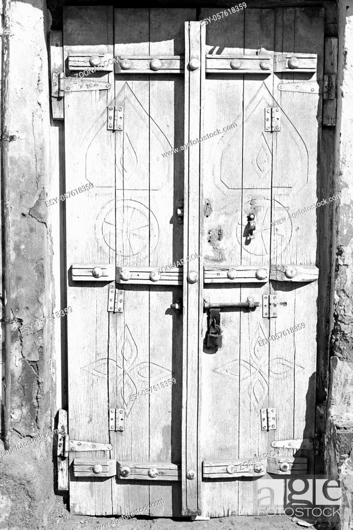 Stock Photo: oman old wooden door and wall in the house.