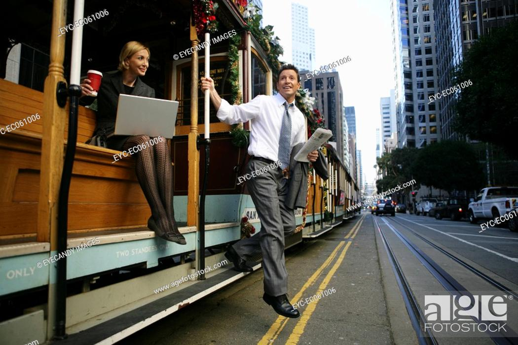 Stock Photo: Man exiting a trolley car.