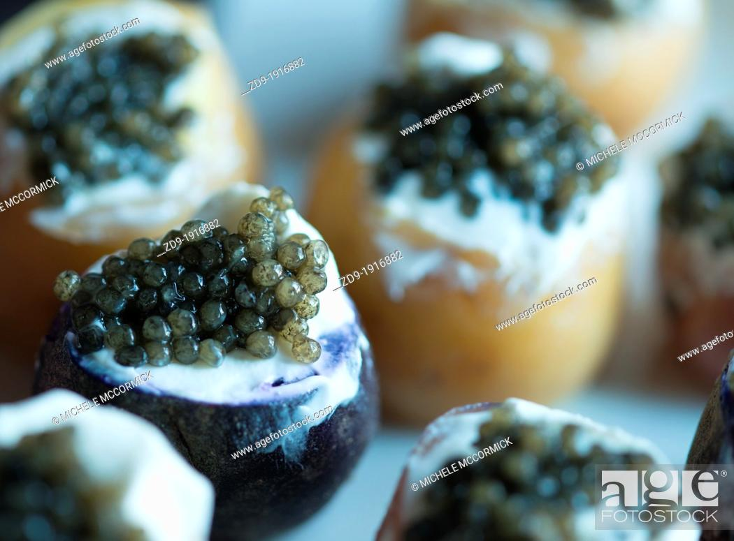 Stock Photo: Caviar potato appetizers are delicious.