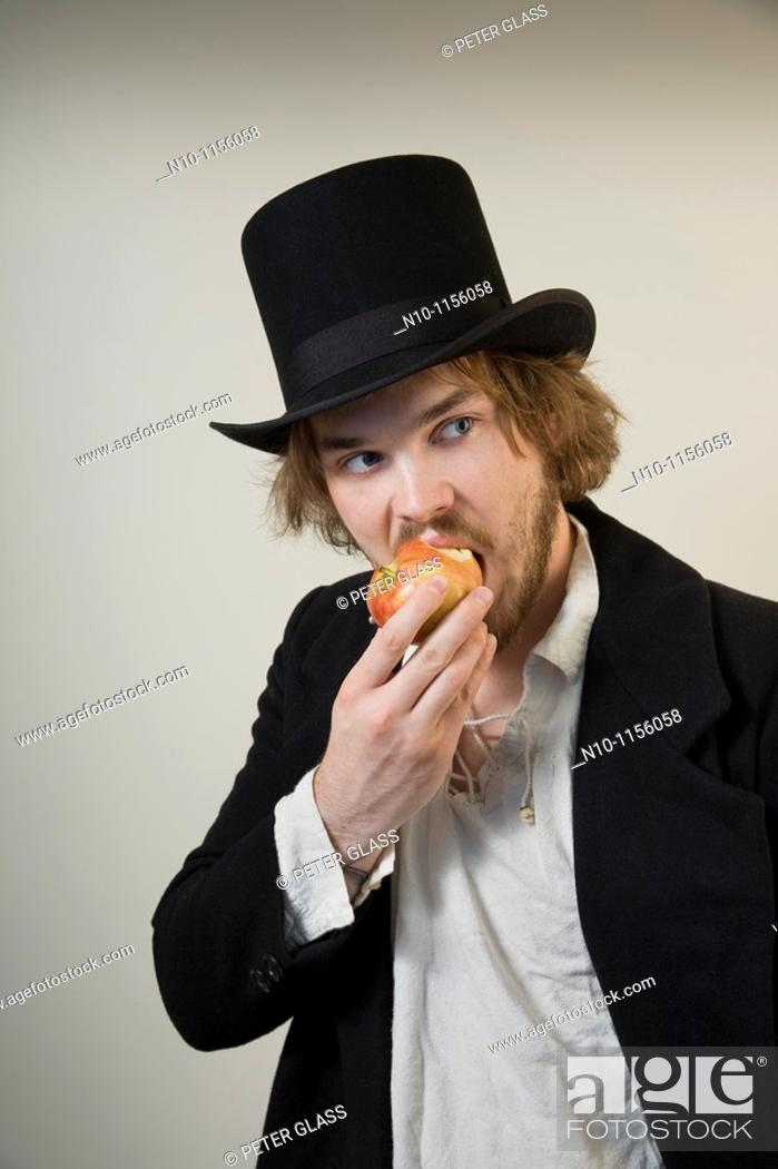 Stock Photo: Young man eating an apple.