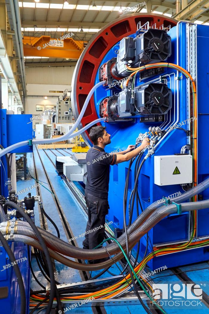 Stock Photo: Hydraulic and electrical installation, Machining Centre, CNC, Turning and Milling lathe. Design, manufacture and installation of machine tools, Metal industry.