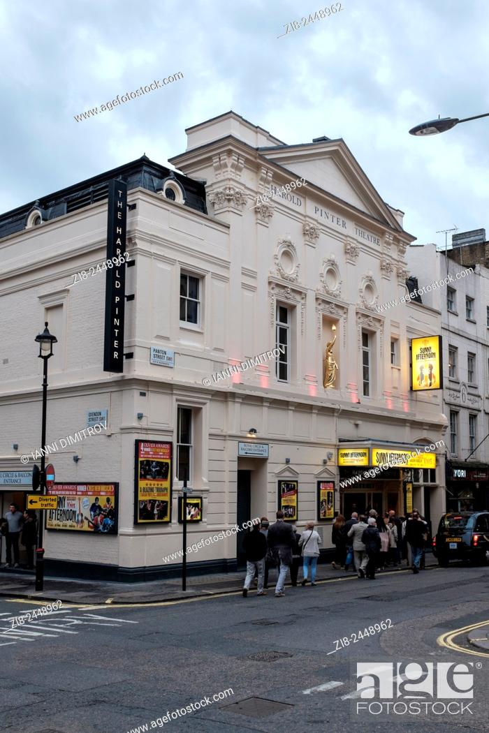 Stock Photo: People queing up for matinee performance, The Harold Pinter Theatre, Panton Street, London.