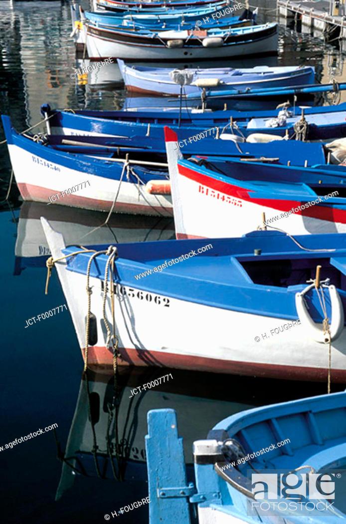 Stock Photo: France, Corsica, Bonifacio, 'pointus' boats in harbour.