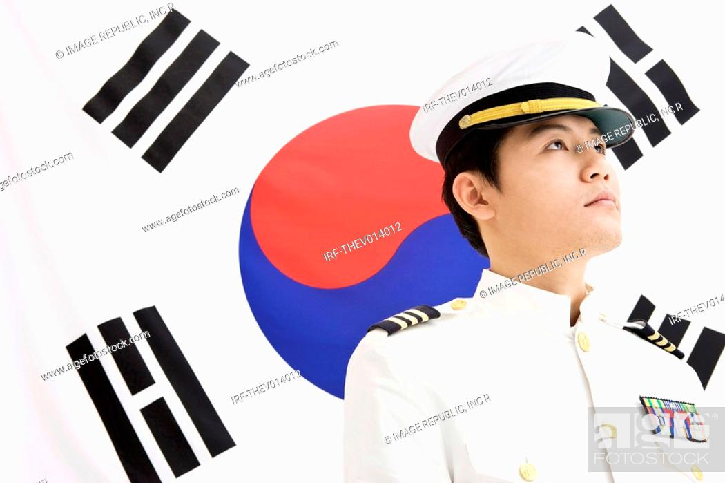 Stock Photo: navy in front of Korean flag, Taegeukgi.