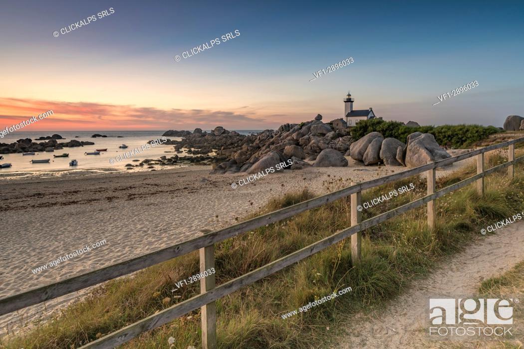 Stock Photo: Sunset behind Pontusval lighthouse. Brignogan Plage, Finistère, Brittany, France.