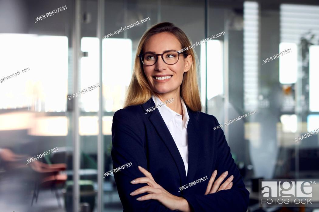 Stock Photo: Portrait of confident businesswoman in office.