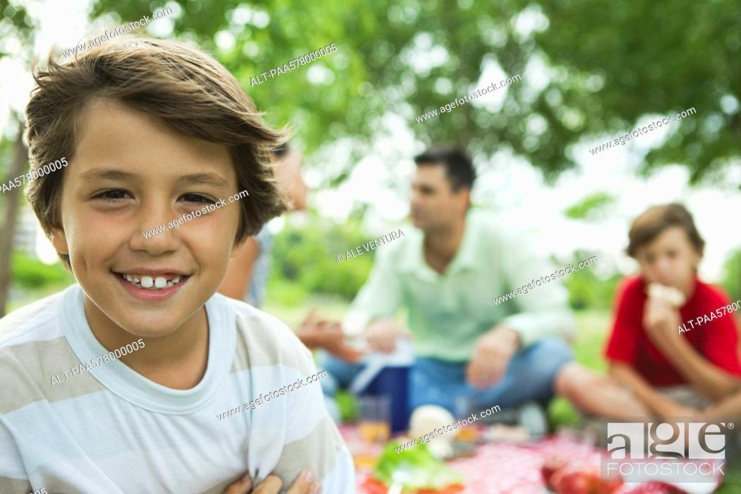 Stock Photo: Boy having picnic with family, portrait.