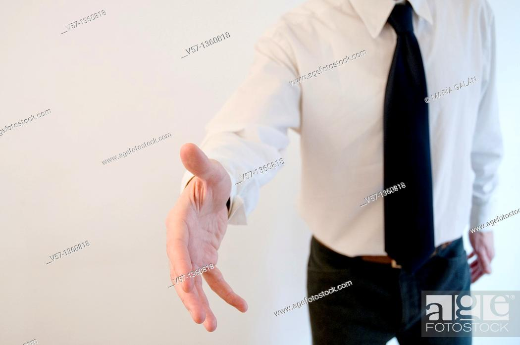 Stock Photo: Man extending his open hand, offering handshake.