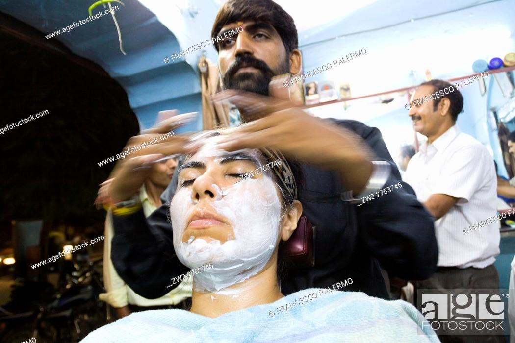 Stock Photo: Barber in action with massage and face care. Jaipur, Rajasthan, India.