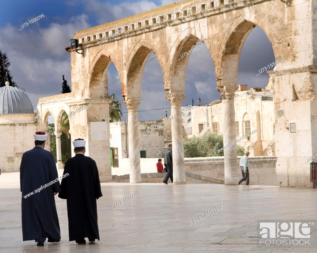 Stock Photo: Imams walk out of the Al Aqsa mosque on the Temple mount in the old city of Jerusalem.