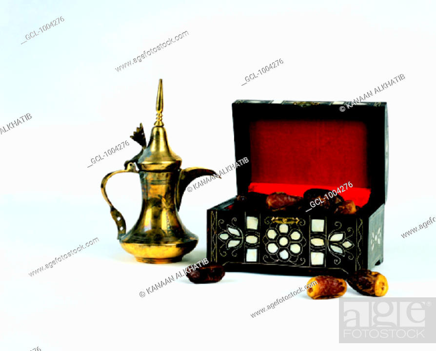 Stock Photo: Arab traditions - dallah (Arabian coffee pot) and a box with dried dates.