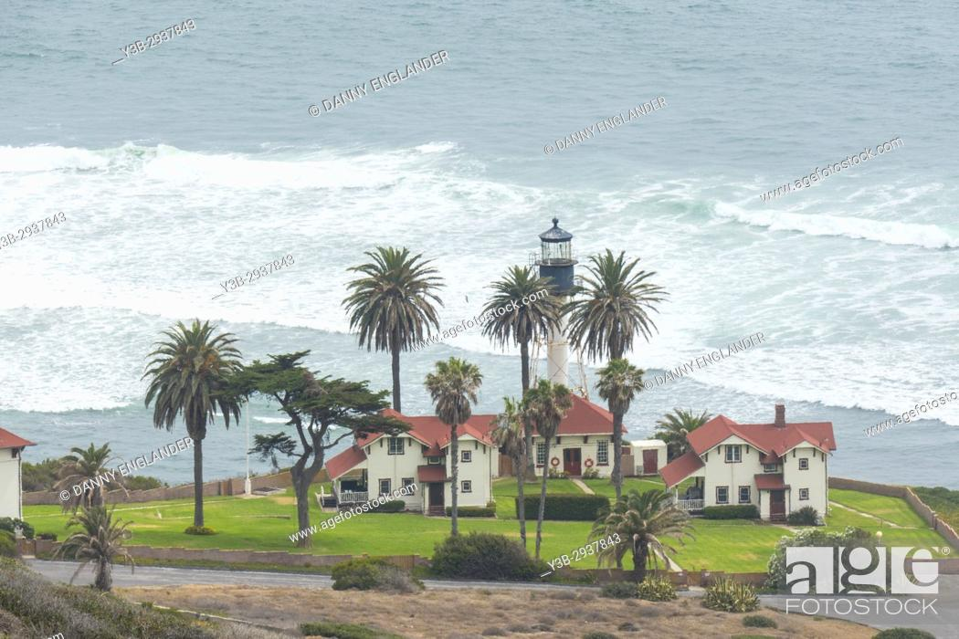 Stock Photo: Lighthouse and palm trees by the Pacific Ocean in San Diego at Cabrillo National Monument.
