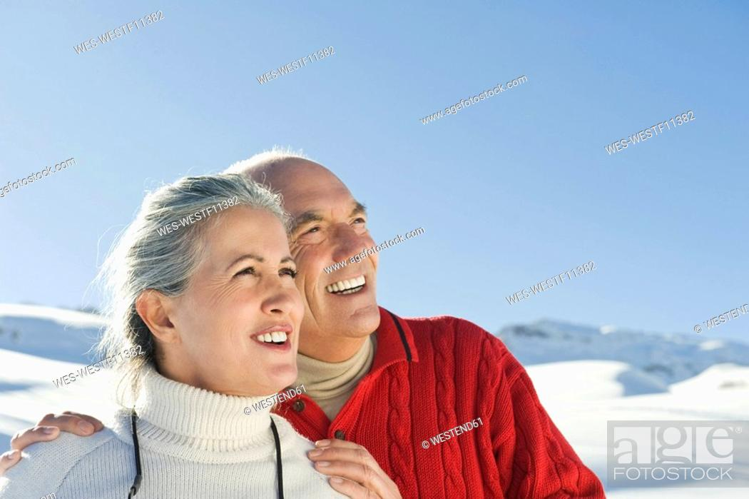 Stock Photo: Italy, South Tyrol, Seiseralm, Senior couple in winterly landscape, portrait, close-up.