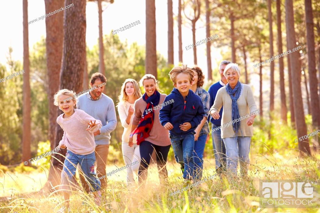 Stock Photo: Multi-generation family walking in countryside, kids running.