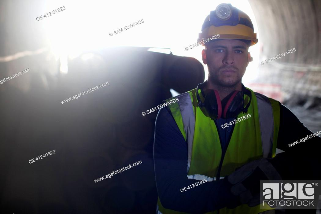 Stock Photo: Worker standing in tunnel.