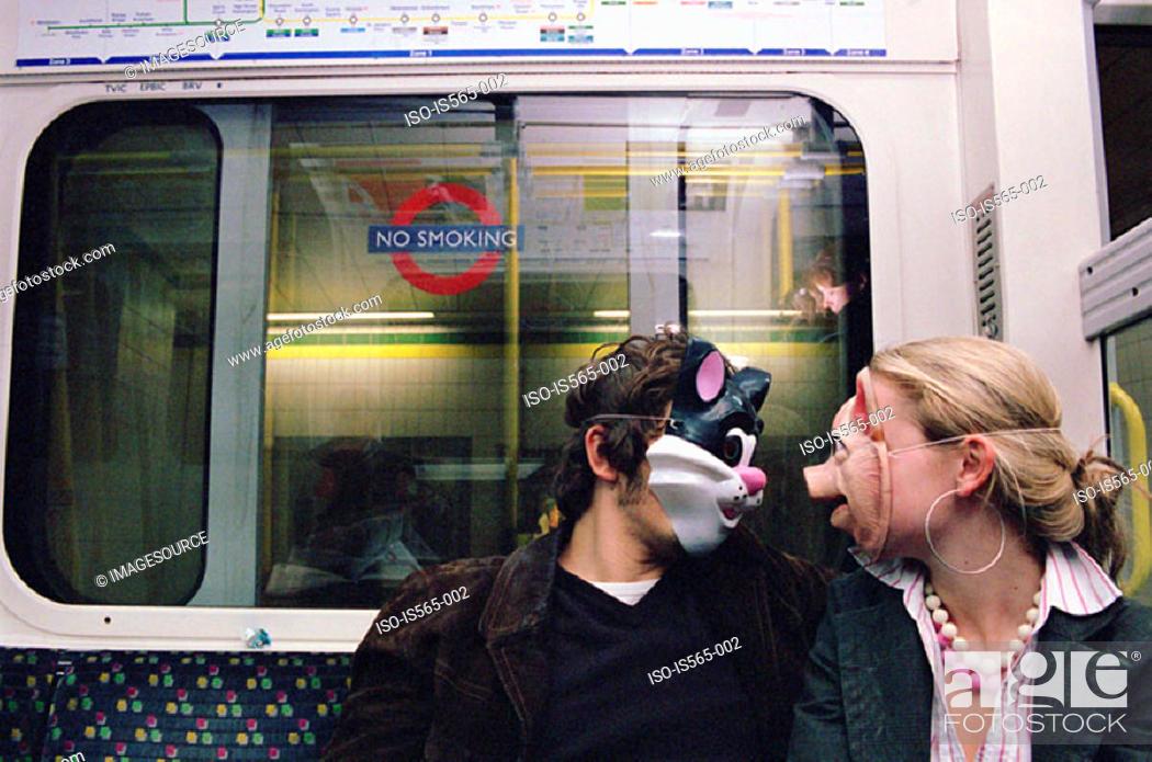 Stock Photo: Couple wearing face masks.
