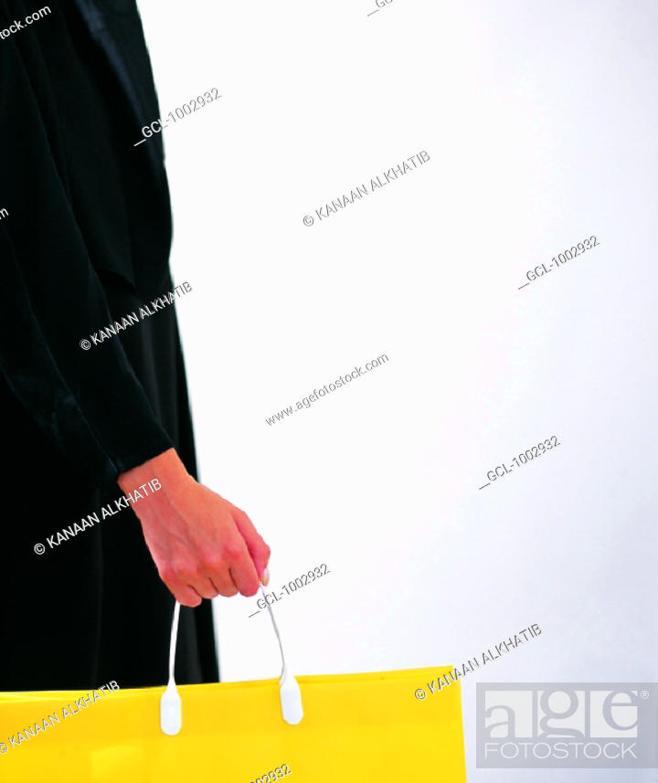Stock Photo: Arab woman holding a shopping bag.