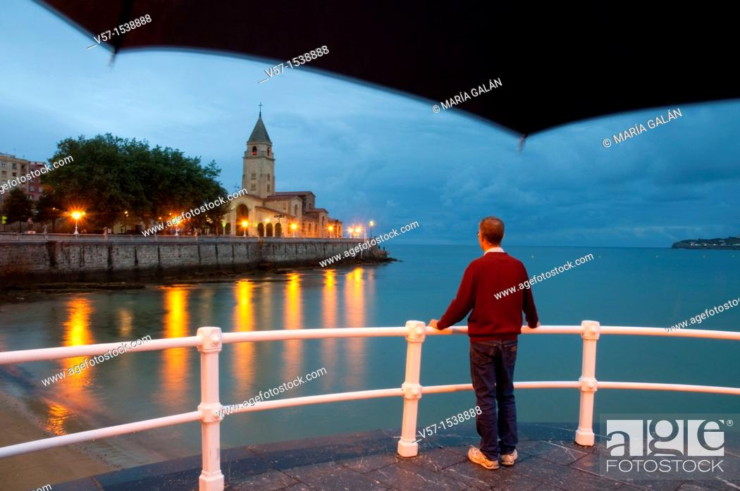 Stock Photo: Man on the promenade, night view. Gijón, Asturias province, Spain.