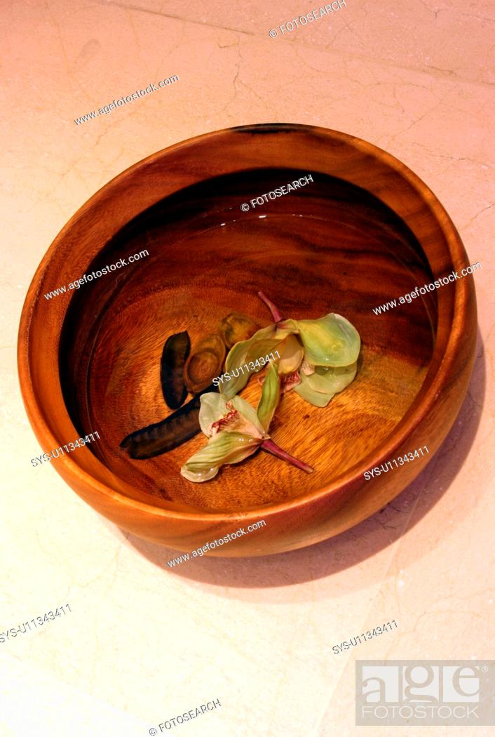 Stock Photo: Bowl of water with flowers.