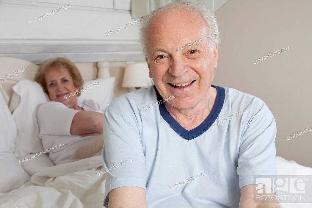 Stock Photo: Couple smiling in the bed.