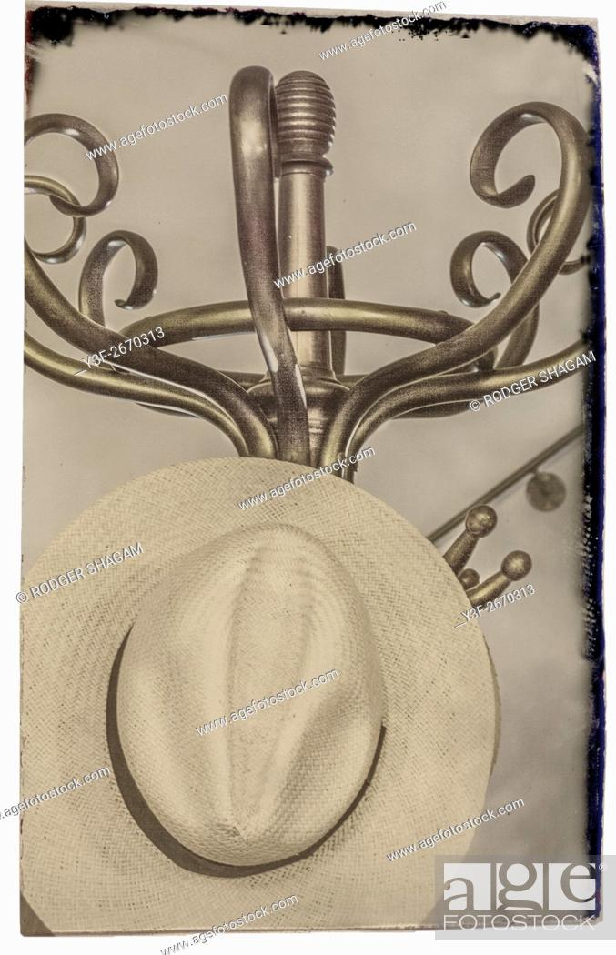 Stock Photo: Panama hot on a bentwood and brass coat stand.