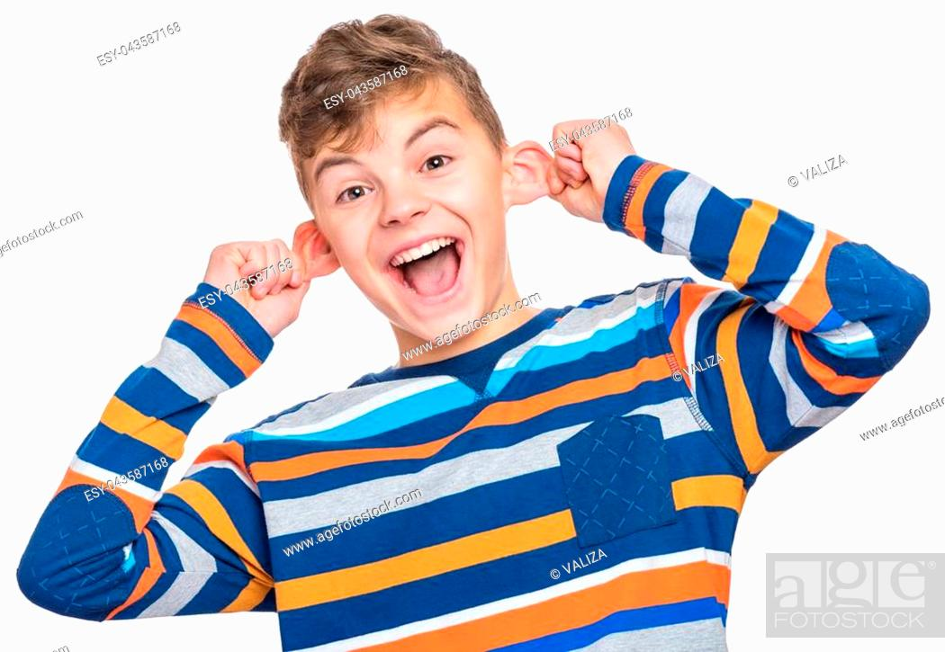 Stock Photo: Silly boy making grimace - funny monkey face. Child with big ears, isolated on white background. Emotional portrait of caucasian teenager looking at camera.