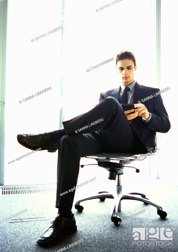 Stock Photo: Businessman sitting in chair.