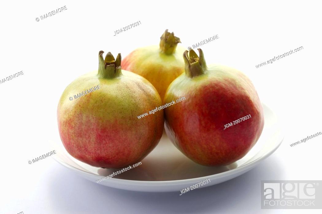Stock Photo: Pomegranates on a plate.