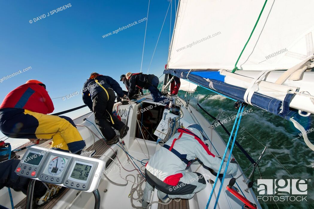 Stock Photo: An busy offshore yacht racing crew sailing.