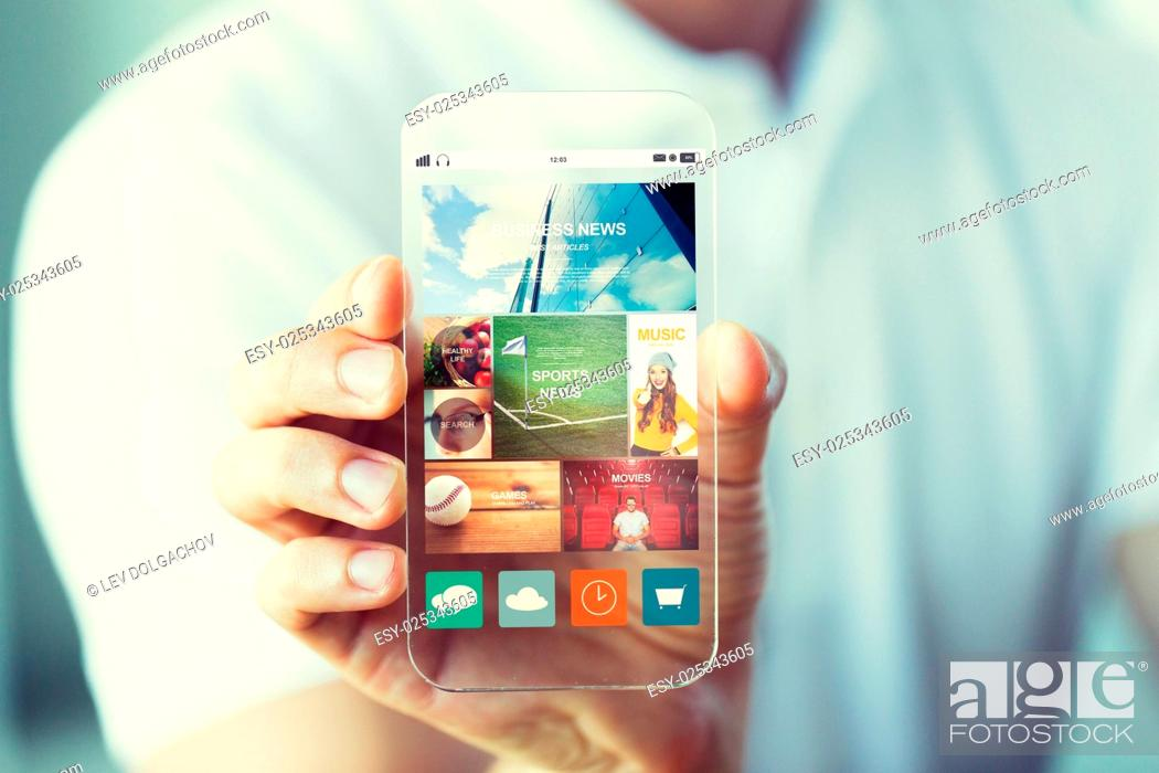Stock Photo: business, technology and people concept - close up of male hand holding and showing transparent smartphone news web page on screen.