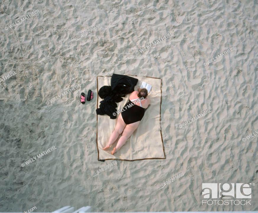 Stock Photo: Obese woman on beach. Usedom. Mecklenburg-Western Pomerania. Germany.