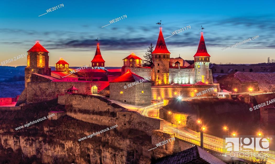 Stock Photo: Kamianets-Podilskyi, Ukraine 01. 07. 2020. Panoramic view of the Kamianets-Podilskyi fortress on a winter night.