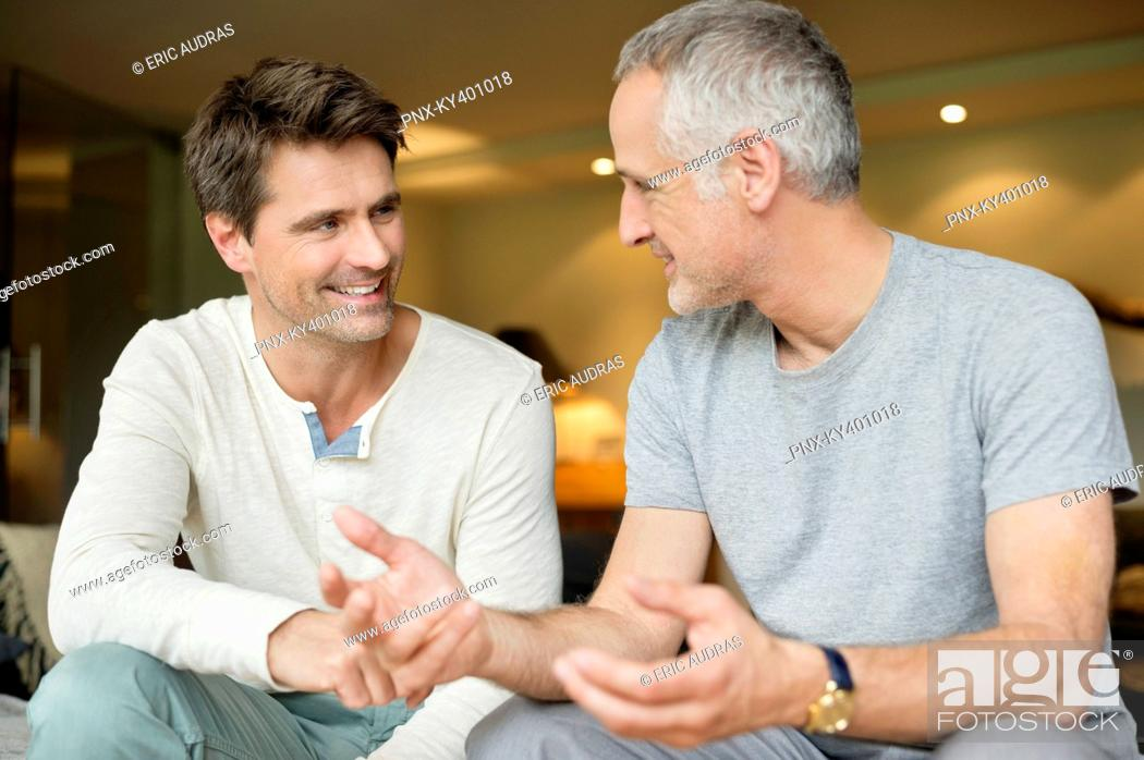 Stock Photo: Two male friends discussing and smiling.