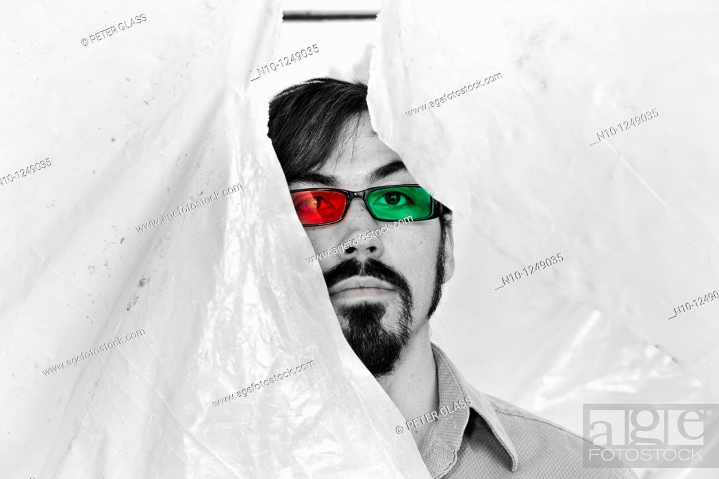 Stock Photo: Young man wearing glasses with red and green lenses.