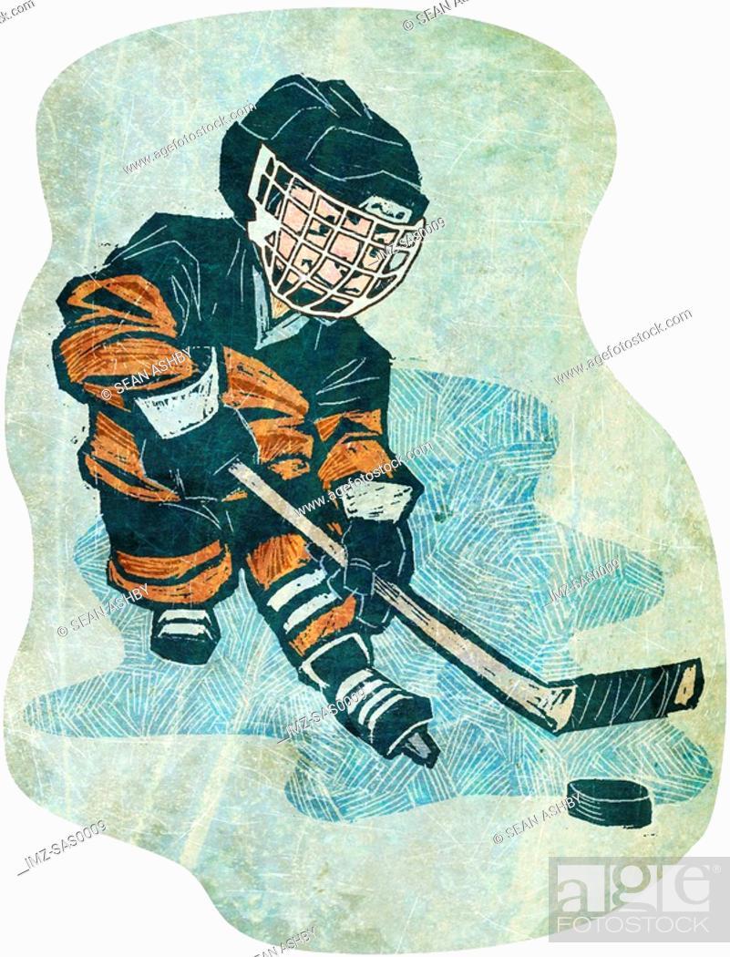 Stock Photo: A boy playing ice hockey.