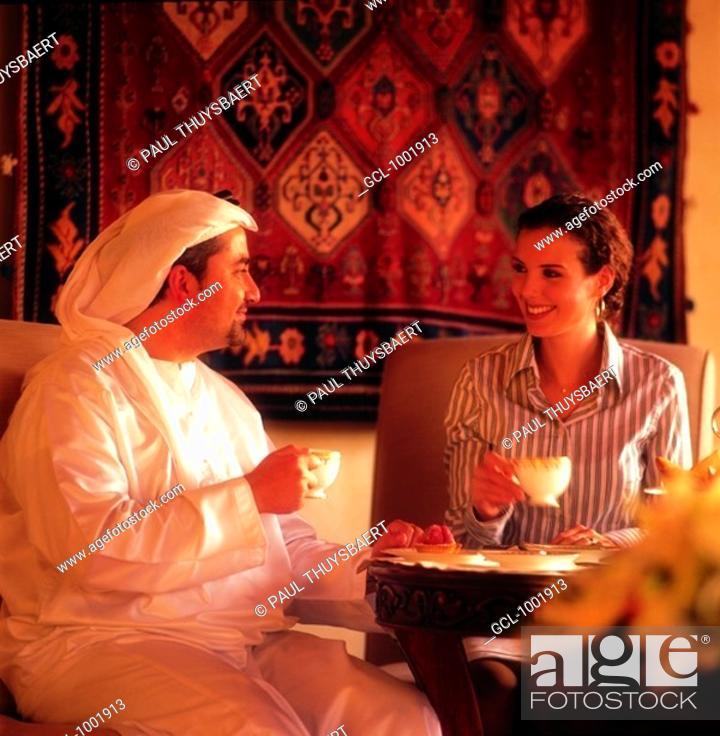 Stock Photo: Businesspeople having coffee.