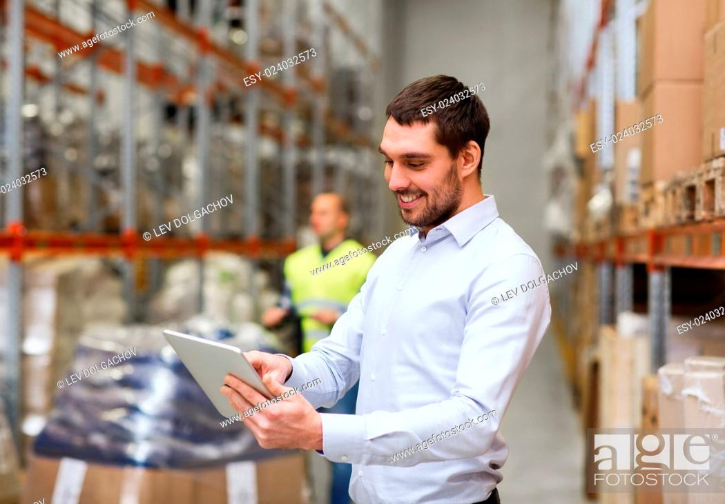 Stock Photo: wholesale, logistic, people and export concept - happy businessman or supervisor with clipboards at warehouse.