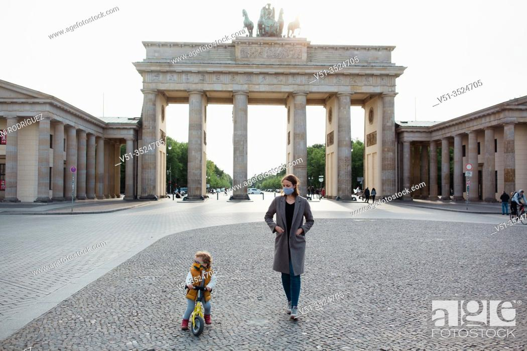 Stock Photo: Mother and son walking in Berlin in Corona days.