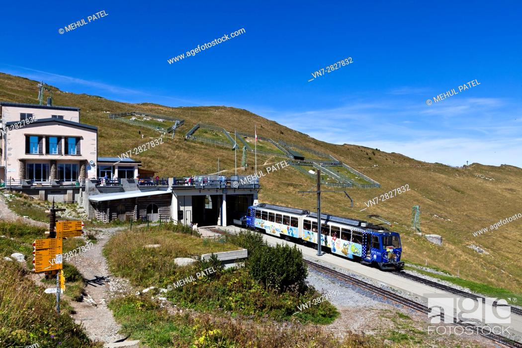 Stock Photo: Cog railway train at station of Rochers-de-Naye close to summit of the mountain, Switzerland, Europe. The train arrives from and departs to Montreux by Lake.