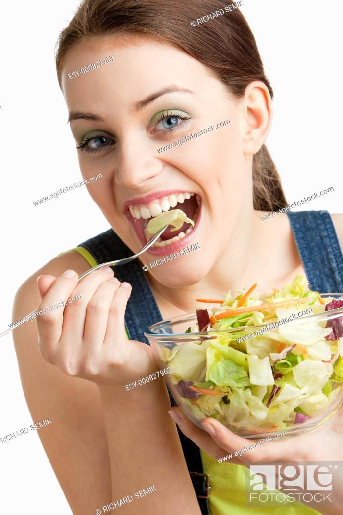 Stock Photo: portrait of woman eating salad.