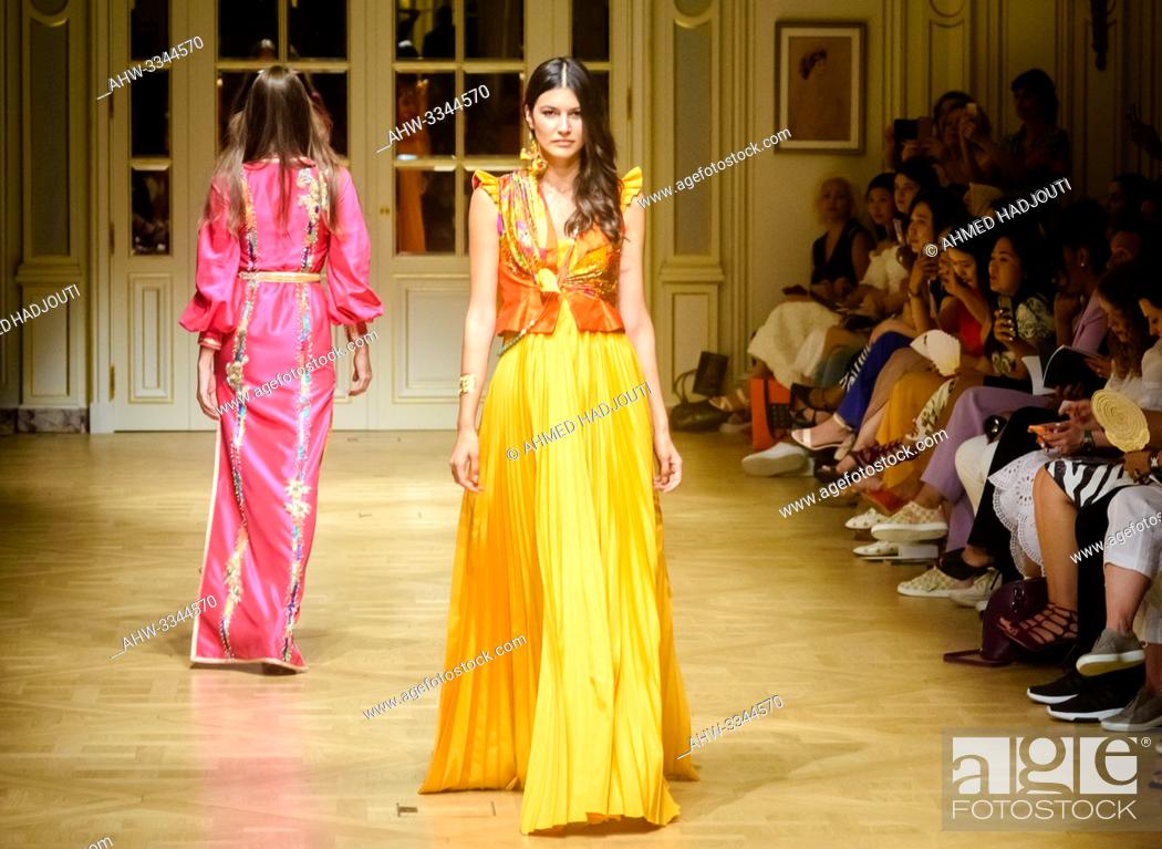 Stock Photo: PARIS, FRANCE - June 30 : A model walks the runway during the Fouad Guerfi Show As part of the Oriental Fashion Show during the Paris Fashion Week Haute Couture.