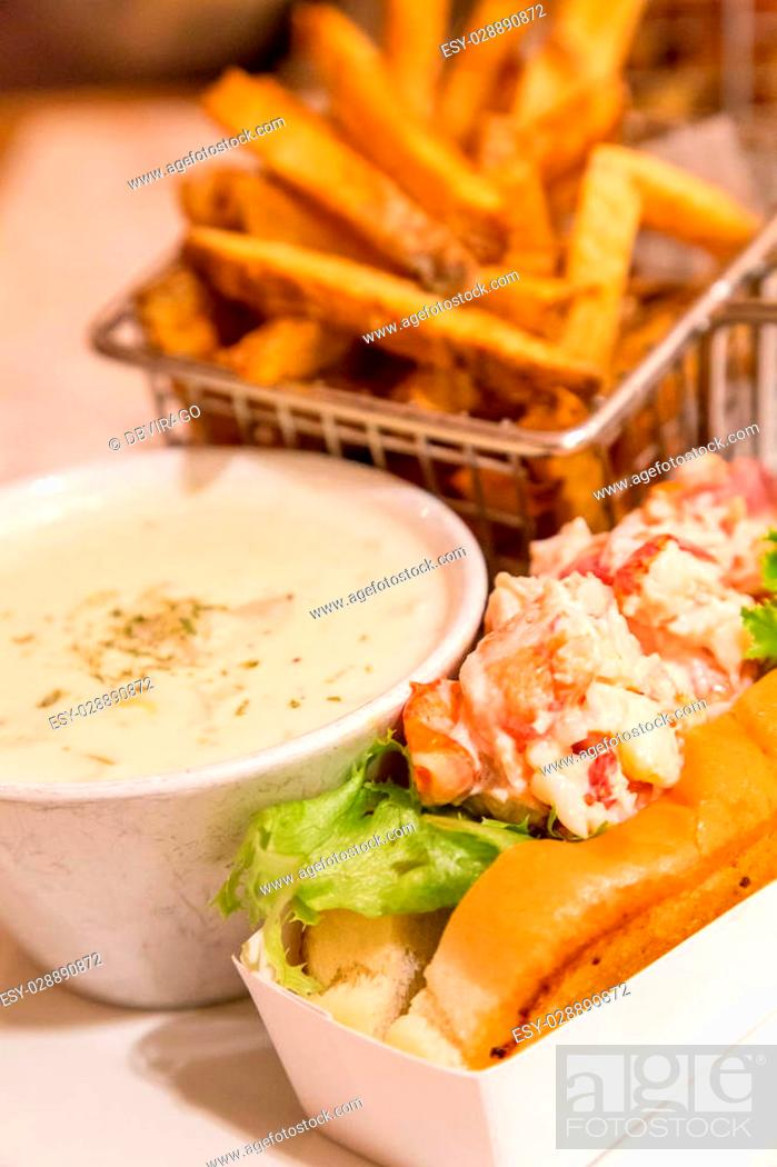 Stock Photo: Traditional Lunch in Bar Harbor, Maine of Lobster roll, lobster bisque and french fries.