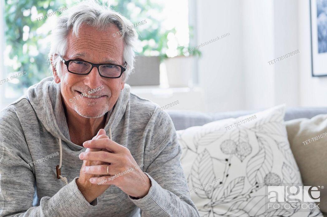 Stock Photo: Portrait of smiling senior man.