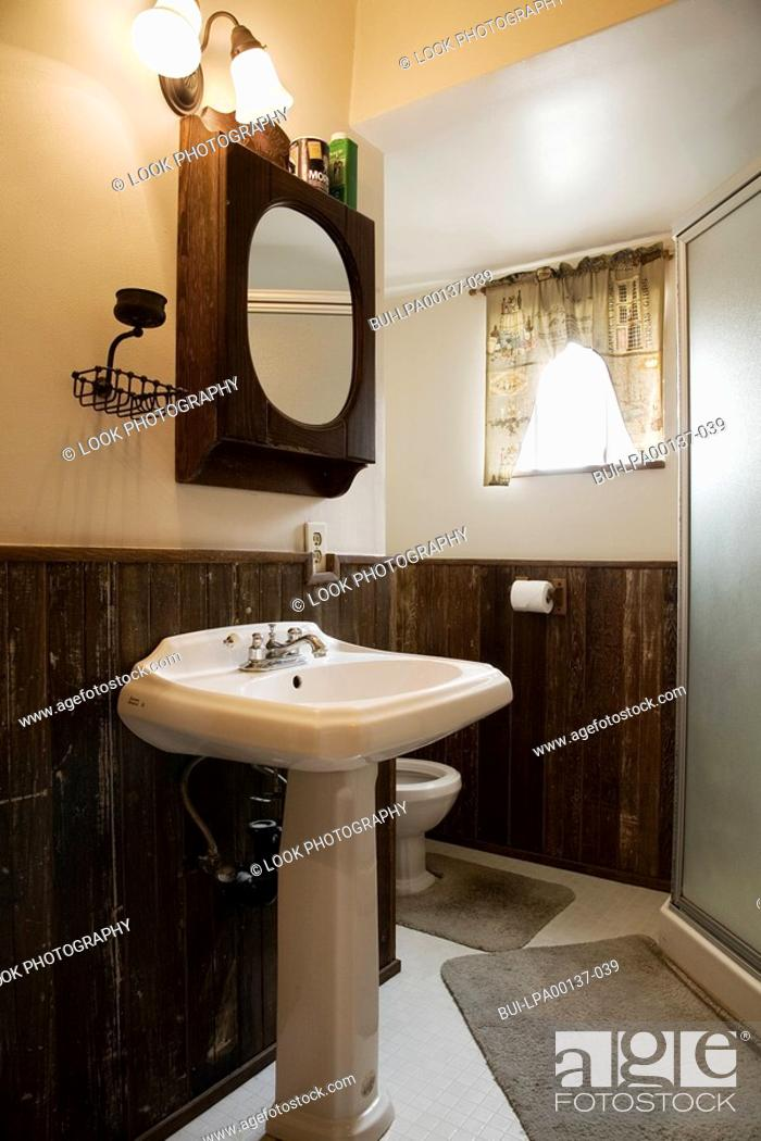 Stock Photo: Small bathroom with a pedestal sink.