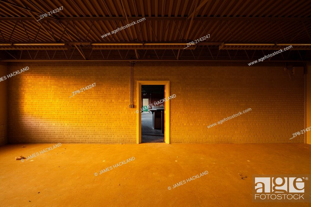 Stock Photo: An empty room with warm sunlight inside an abandoned church in Oakville, Ontario, Canada. This Church has been demolished so there is no property release needed.