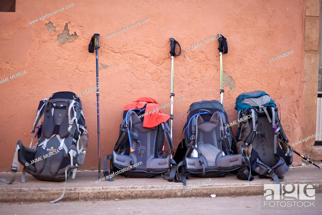 Stock Photo: Rucksacks lined up on street.