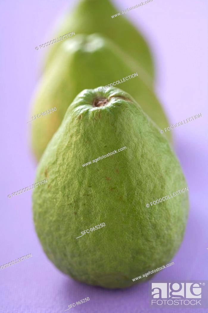 Stock Photo: Three guavas.