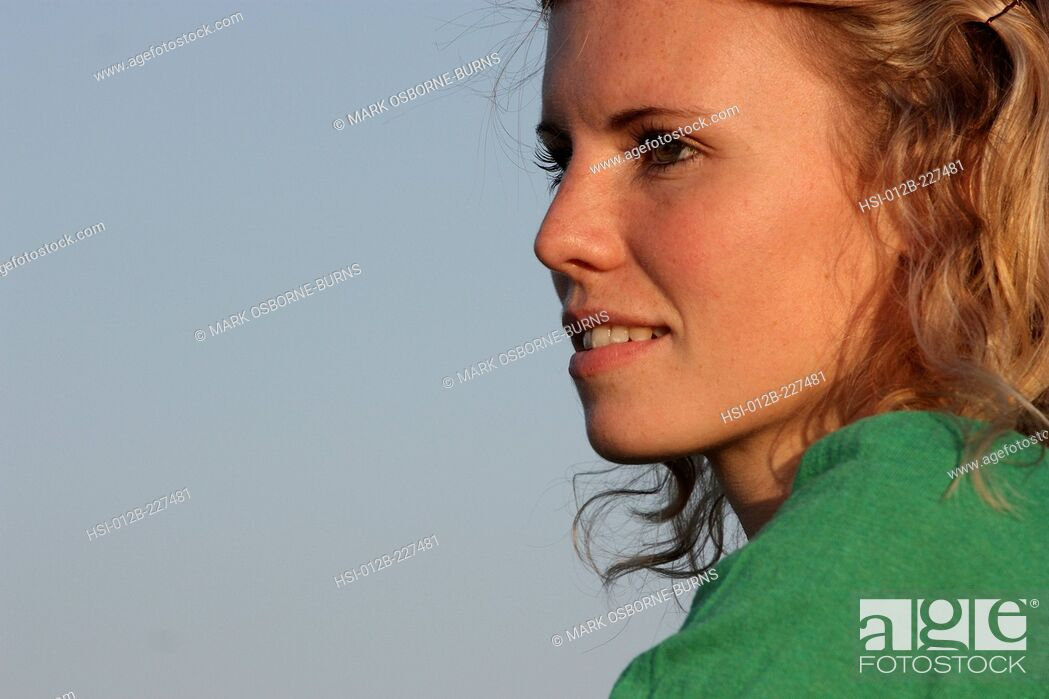 Stock Photo: Portrait of young blonde woman outdoors.
