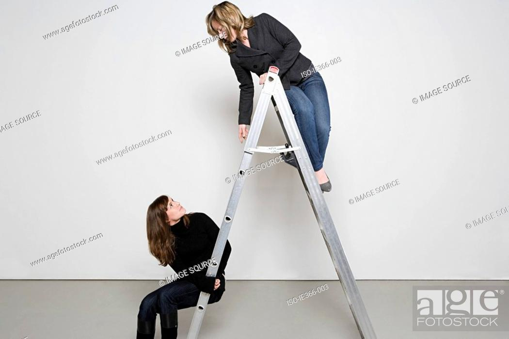 Stock Photo: Two women on step ladder.