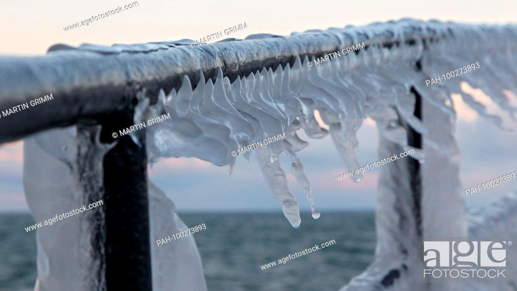 Stock Photo: Huge icicles formed by waves hanging on frozen ship's rail, Baltic Sea, Mecklenburg-Western Pomerania, Germany | usage worldwide.